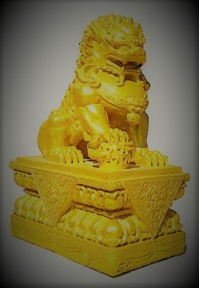 Golden Chinese lion statue in the temple of thailand